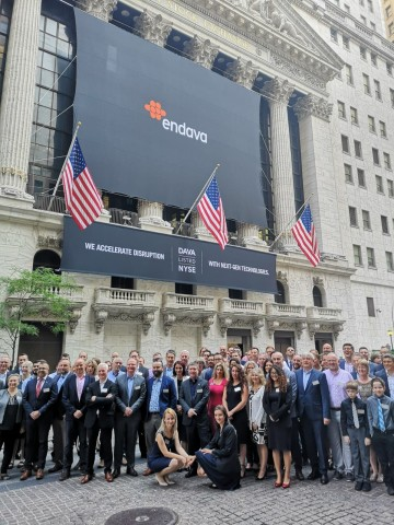 """Endava employees gathered at the New York Stock Exchange to celebrate Endava opening for trading under the ticker symbol """"DAVA"""" following its initial public offering. (Photo: Business Wire)"""