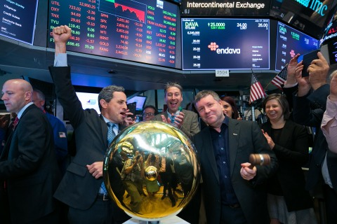 """Part of the Endava leadership team and founders celebrate Endava opening for trading under the ticker symbol """"DAVA"""" following its initial public offering. (Photo: Business Wire)"""