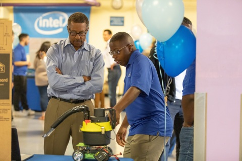Intel intern Da'Quann Karanja (right) demonstrates his team's Cleanzi City Wide Cleaning Rover for litter abatement. On completion of their six-week paid internships, 37 interns from Oakland Technical and McClymonds high schools presented projects, many incorporating Intel Corporation technology, to their families, schools and communities during a presentation in Oakland, Calif., on Thursday, July 26, 2018. (Credit: Intel Corporation)