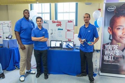 Intel interns (from left) Chibuzo Ezeokoli, Abdulhadi Hussein and Edrees Saied pose with their project DTechT, an artificial intelligence-based car-theft deterrent system. On completion of their six-week paid internships, 37 interns from Oakland Technical and McClymonds high schools presented projects, many incorporating Intel Corporation technology, to their families, schools and communities during a presentation in Oakland, Calif., on Thursday, July 26, 2018. (Credit: Intel Corporation)