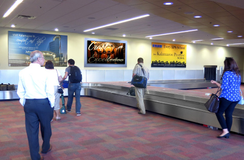 "Clear Channel Airports new cutting-edge media network will include upgrading two 86"" LCDs on the baggage claim back wall. Engaging advertising strongly connects brands with business travelers, tourists and local residents alike. (Photo: Business Wire)"