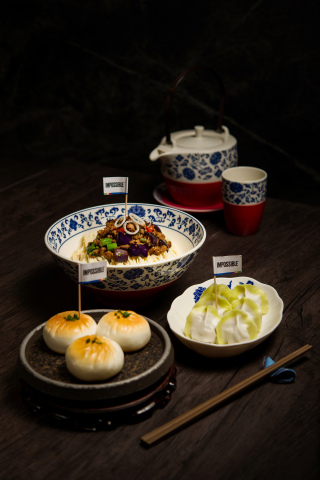 The Noodle Kitchen highlights Impossible meat in three traditional Chinese dishes: Seared Buns, Chive Dumplings, and Tossed Noodles with Spiced Eggplants. (Photo: Business Wire)