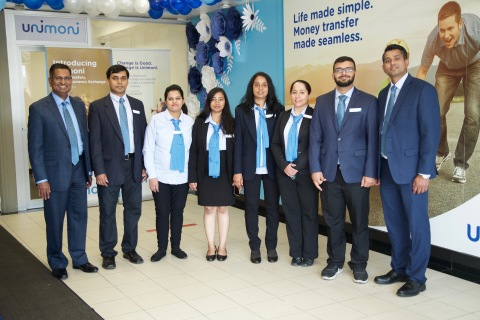Ajit Paul, Regional Head-APAC (extreme left) and Rajesh Pazhassi Veettil, Country Head of Unimoni Canada (extreme right), with the staff during the launch of Unimoni brand in Canada. (Photo: AETOSWire)