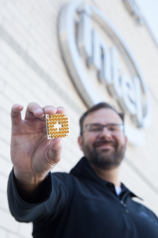Intel's director of quantum hardware, Jim Clarke, holds a 17-qubit superconducting test chip. (Credit: Intel Corporation)