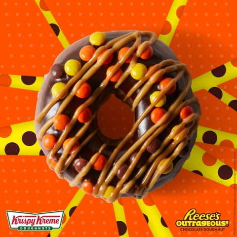 The new Krispy Kreme Reese's Outrageous Doughnut is available starting today, Aug. 6 for a limited t ...