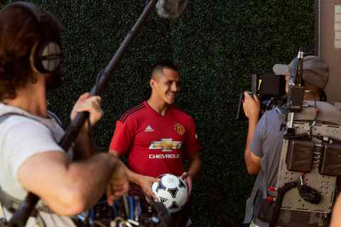 """Manchester United forward, Alexis Sanchez, smiles down the lens during a Chivas film shoot in July in Los Angeles, United States. The film was released to announce Chivas as the """"Official Global Spirits Partner"""" of Manchester United. Photographer: Monroe Alvarez"""