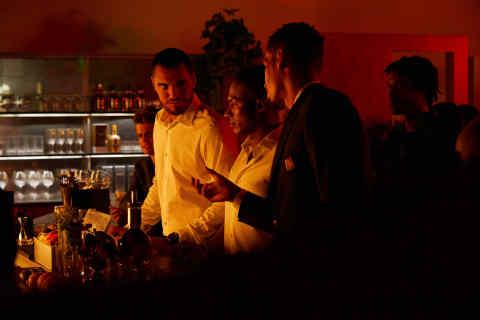 Manchester United teammates Sergio Romero, Antonio Valencia and Chris Smalling (L-R) raise a glass t ...
