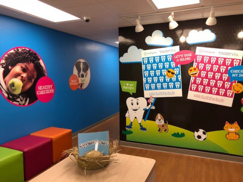 """Bold graphics and a """"selfie"""" wall make going to the dentist fun for children who visit the new Weste ..."""