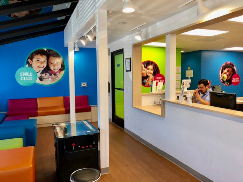 Primary colors brighten up the reception area of the new Western Dental Kids office in downtown Modesto. (Photo: Business Wire)