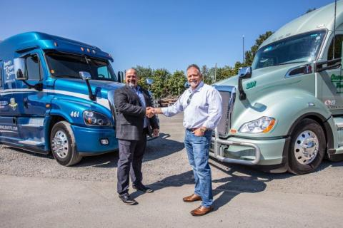 Ron Riddle, CEO of Leavitt's Freight Service (left), joins Rick Williams, CEO of Central Oregon Truck Company (right), as a member of the Daseke family. (Photo: Business Wire)