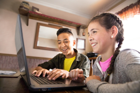 Two kids using Comcast's Internet Essentials program to connect to the Internet. Internet Essentials ...