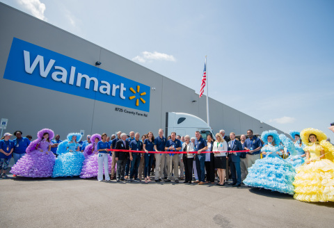 Walmart executives, Governor Kay Ivey and local and state officials celebrate the grand opening of the $135 million import distribution center in Irvington. The distribution center will help support more than 700 Walmart stores across the South. (Photo: Business Wire)
