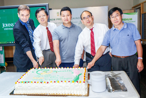 Dr. Chunyu Zhang, the founder, Mr. Chunshui Liu, the partner, and the guests take a group photo (Pho ...