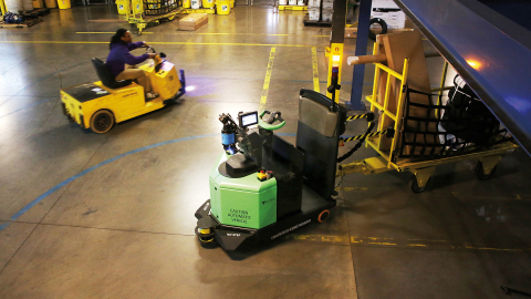 At FedEx Ground hubs, high-tech helpers work alongside team members for maximum efficiency. At the hub in Greensboro, North Carolina, self-driving tuggers move large or overweight packages. We're also testing automated devices that can unload trucks. (Photo: FedEx Corporation)