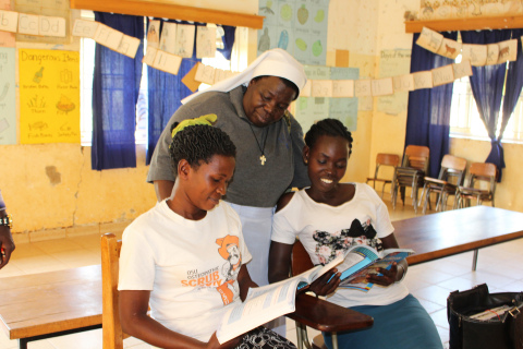 Sister Rosemary Nyirumbe assists students at St. Monica's Vocational School in Gulu, Uganda, a schoo ...