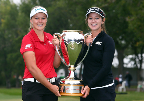 Skechers GO GOLF elite athlete Brooke Henderson (left) celebrates her CP Women's Open win with siste ...