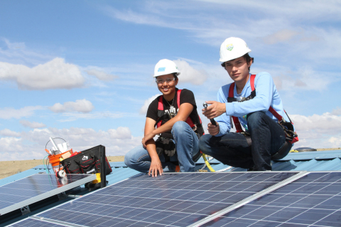 A tribal job trainee (left) and GRID Alternatives SolarCorps Fellow (right) install solar for the Na ...