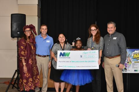 Alexzandra Shade, Chuck Molina, and Jeff Bentley present the $10,000 check to the Inova Cares Clinic ...