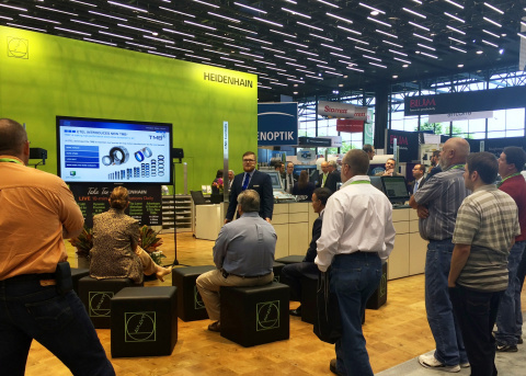 HEIDENHAIN product expert conducts a torque motor presentation at IMTS trade show. (Photo: Business  ...