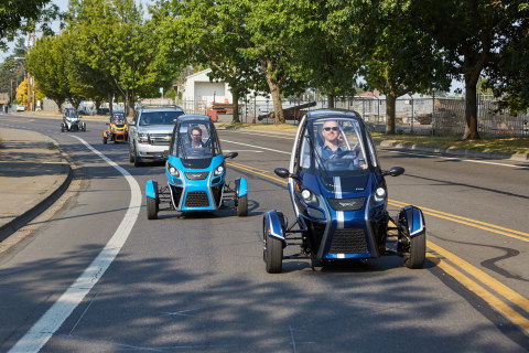Arcimoto FUVs flank the ceremonial first Uber ride through Eugene streets. (Photo: Business Wire)