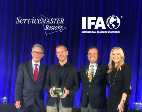 Mark Ralph (second from left), owner of ServiceMaster Absolute Water and Fire Damage Services in Chula Vista, Calif., was presented franchise of the year award by the International Franchise Association during the annual Franchise Action Network meeting. (Photo: Business Wire)