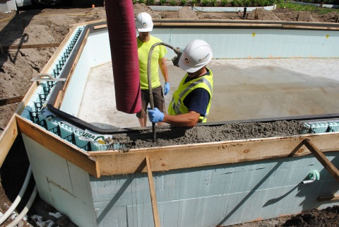 Pictured is one of Nudura's insulated concrete forms (ICF) being installed. Nudura provides four series of ICF wall systems, consisting of foam boards made from expanded polystyrene and integral hinged plastic webs that hold both sides of the boards together. Concrete is then poured into the form to make an insulated concrete wall system. (Photo: Business Wire)