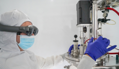 In a cleanroom gown, a lab technician uses Apprentice's conversational UI for a fully immersive AR experience in accessing procedural data and 3-D technique demonstrations on how to prepare a bioreactor. (Photo: Business Wire)