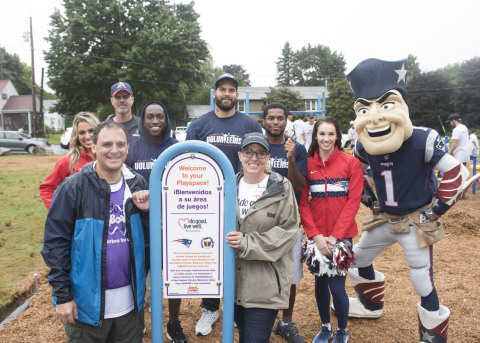 Representatives from the New England Patriots, UnitedHealthcare and Blackstone Valley Prep celebrate the completion of the new 3,000-square-foot playground at Blackstone Valley Prep Elementary School 3 (Photo: Alan Grant).