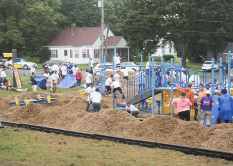 The playground at Blackstone Valley Prep Elementary School 3 progresses as volunteers from UnitedHealthcare and members of the community work through the rain. This project, a collaboration between UnitedHealthcare, the New England Patriots and KaBOOM!, is the 9th playground the three have built together (Photo: Alan Grant).