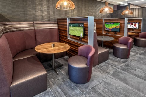 Personal television screens provide privacy in the lobby's booths. (Photo: Business Wire)