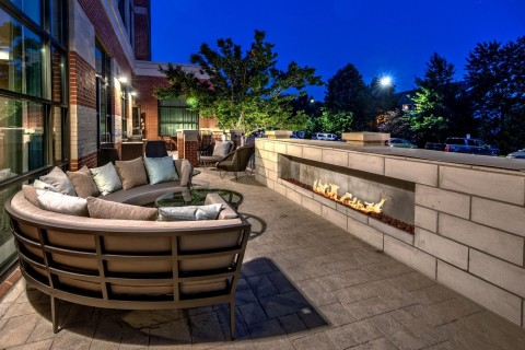 As the evenings get cooler, guests can gather around a fire pit on the patio. (Photo: Business Wire)