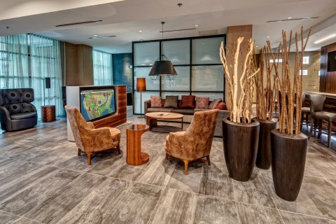 The warm, modern lobby is a natural place to watch the news. (Photo: Business Wire)
