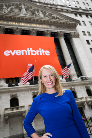Julia Hartz, Eventbrite CEO in front of the NYSE facade. (Photo Credit: NYSE)