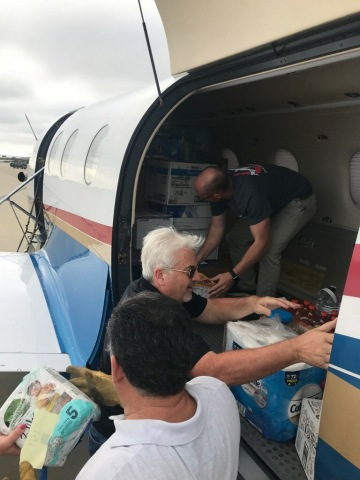 LabCorp's Ken Hopper and others loading plane with hurricane relief supplies. (Photo: Business Wire)
