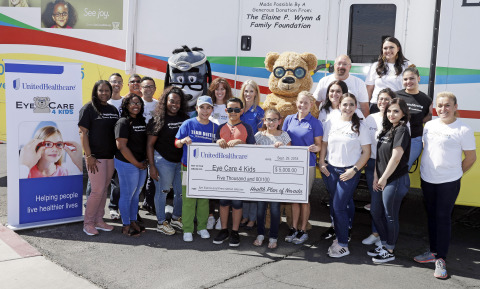 Kelly Simonson, president of Health Plan of Nevada (center) and, to her right, Stephanie Kirby, executive director of Eye Care 4 Kids, joined UnitedHealthcare volunteers for a $5,000 check presentation to Eye Care 4 Kids Nevada during a no-cost comprehensive eye exam as part of eye health event Saturday, Sept. 29, 2018, in Las Vegas. The event is part of a nationwide grant program by UnitedHealthcare (Photo: Isaac Brekken).