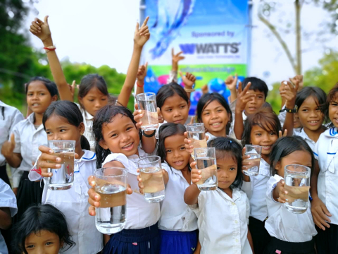 Children from Cambodia's Svay Leu District celebrate on Oct. 1, 2018 after Watts Water Technologies  ...