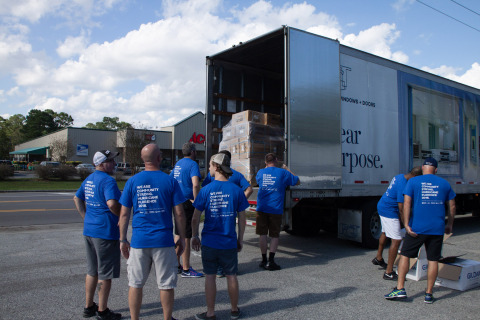 PGT Innovations' team members unloading supplies. (Photo: Business Wire)