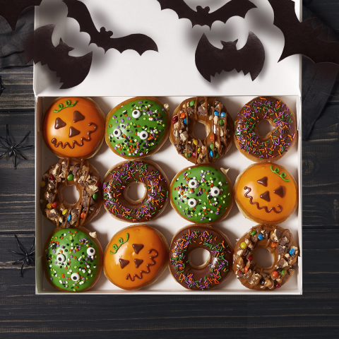 Krispy Kreme Doughnuts announced the launch of their Halloween doughnut collection, which features the new candy-covered Trick-or-Treat Doughnut, the new Monster Batter Doughnut, the Jack-o-Lantern Doughnut and the Chocolate Iced with Halloween Sprinkles Doughnut. All are available today through Oct. 31 at participating U.S. Krispy Kreme shops. (Photo: Business Wire)