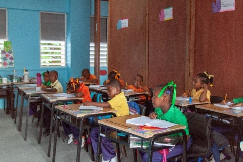 Students happy to be back in the classrooms at the Paix Bouche Primary & Pre-School (Photo: Business Wire)