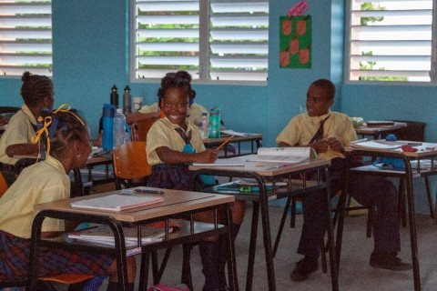 Students happy to be back in the classrooms at the Paix Bouche Primary & Pre-School (Photo: Business ...