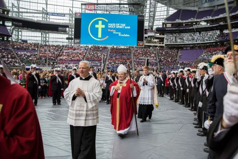 Archbishop Bernard A. Hebda leads the procession into the Mass of the Holy Spirit at U.S. Bank Stadium. (Photo: Bob Cunningham)