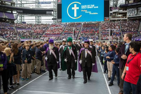 The Knights of Columbus sponsored the Mass of the Holy Spirit at U.S. Bank Stadium. They collected winter coats and items for their Coats for Kids program. (Photo: Bob Cunningham)