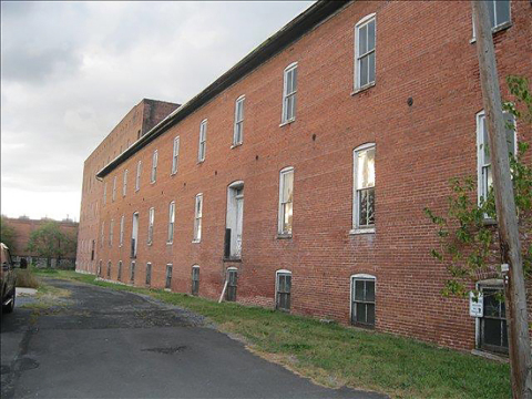 This former tobacco warehouse will be converted into a 66-unit apartment community. (Photo: Business ...