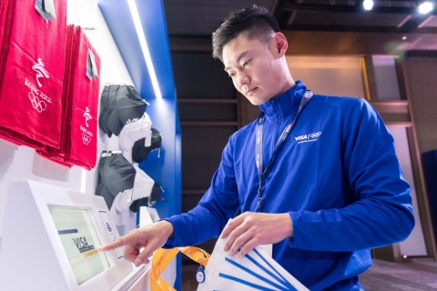 Zhang Peimeng (China, Athletics & Skeleton) uses a 'smart shopping bag' to purchase Beijing 2022 Olympic gear and save time at checkout. As the Official Payment Technology Partner through 2032, Visa is piloting payment innovations that will enhance the on-site and at-home Olympic experience for the fan of the future. (Photo: Business Wire)