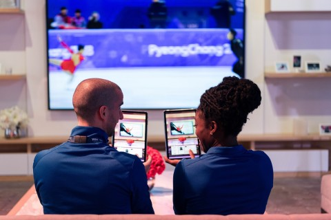 (Left to right) Benoit Huot (Canada, Para swimming) and Seun Adigun (Nigeria, Bobsleigh) demo 'couch commerce' where Olympic fans will be able to make purchases in real-time through an in-home omni-channel shopping experience. (Photo: Business Wire)