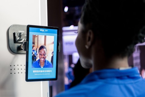 Team Visa athlete Seun Adigun (Nigeria, Bobsleigh) previews biometric authentication that verifies tickets purchased and expedites entry to venues and acts an integrated payment form factor to enhance fan experience on-site. (Photo: Business Wire)