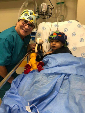 Kathleen Fodor, RN with a child from Ecuador after surgery. (Photo: Business Wire)