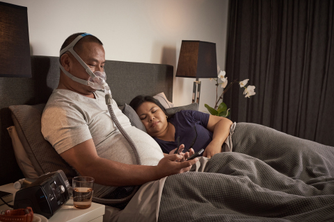 AirFit F30 full face CPAP mask: Man wearing in bed (Photo: Business Wire)