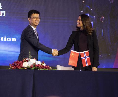 Simon Hu, Senior Vice President of Alibaba Group and President of Alibaba Cloud, and Hege Skryseth,  ...