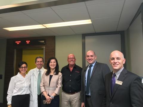 Pictured left to right: Mrs. Alexandra Ackerman, Dr. Scot Ackerman, Ms. Tina Yu, Mr. John Ostler, Mr. Yoel Bakas, Mr. Mark Jones at the 1000th Patient Celebration at Ackerman Cancer Center. (Photo: Mevion Medical Systems)